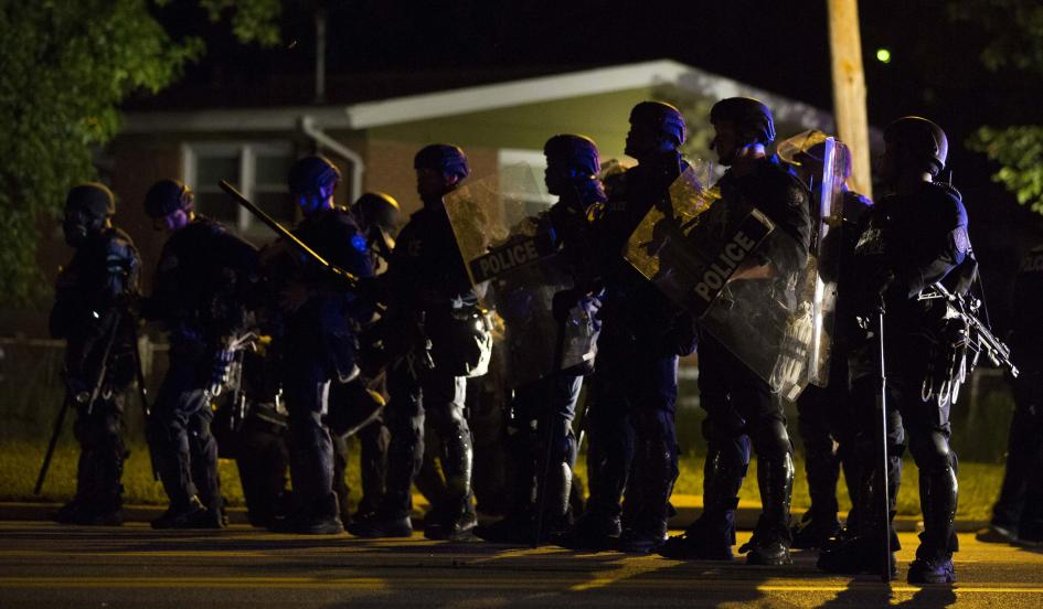 Police officers patrol a street in Ferguson, Missouri August 11, 2014 Mario Anzuoni/Reuters